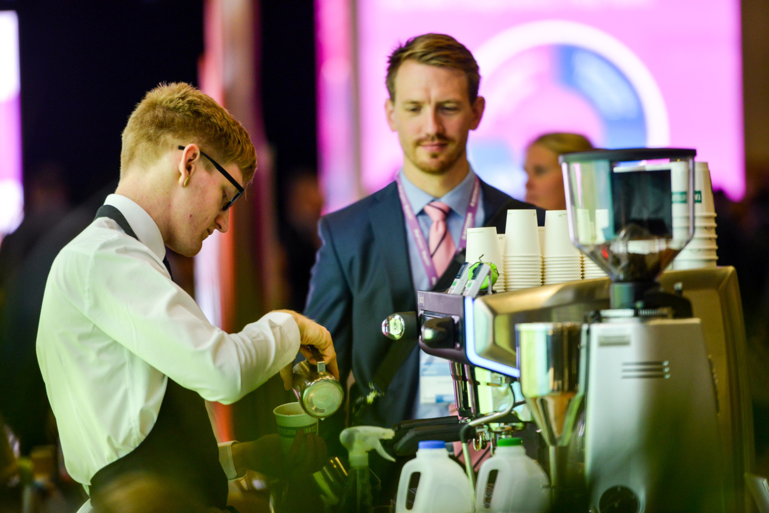 Serving coffee to an exhibition guest