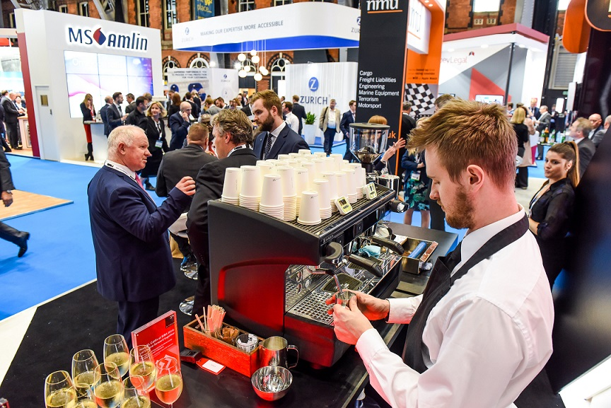 barista preparing a coffe at a busy event