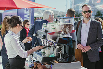 mobile coffee bar and barista at a public event